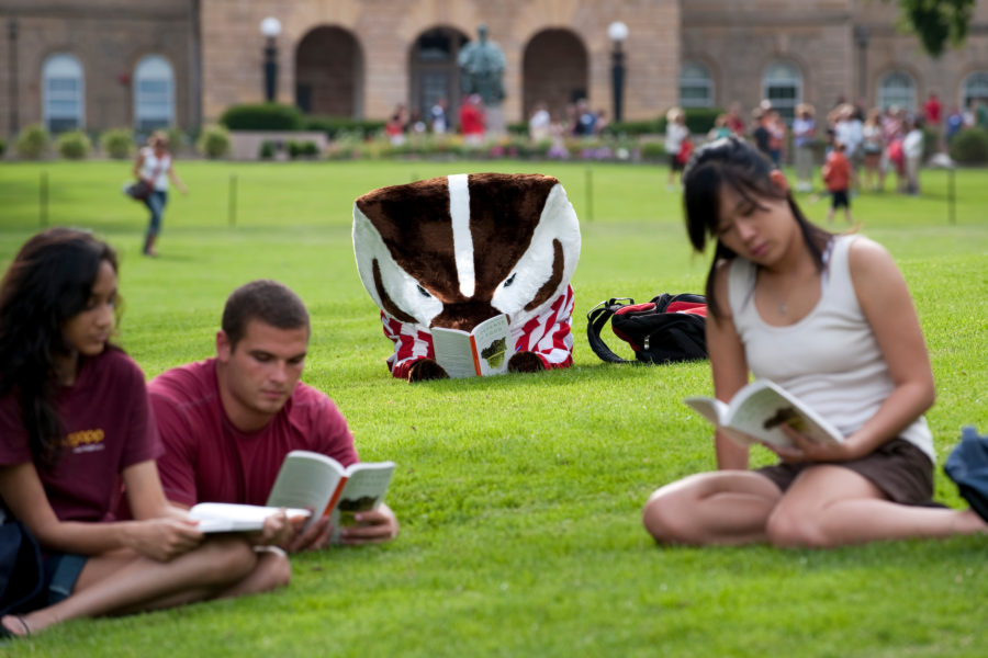 UW-Madison students and Bucky reading on Bascom Hill
