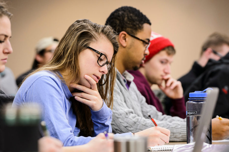 Undergraduate students take notes during a geoscience class