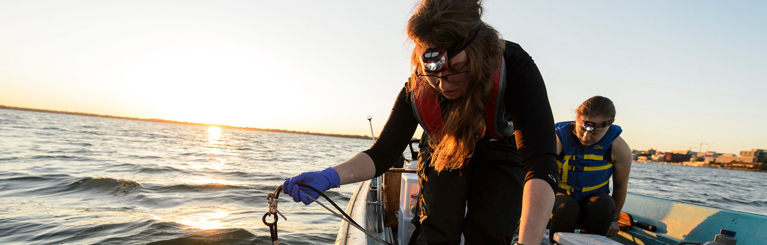 UW-Madison graduate students Alexandra Linz and Carolyn Voter collect data and water samples from Lake Mendota near the University of Wisconsin-Madison campus